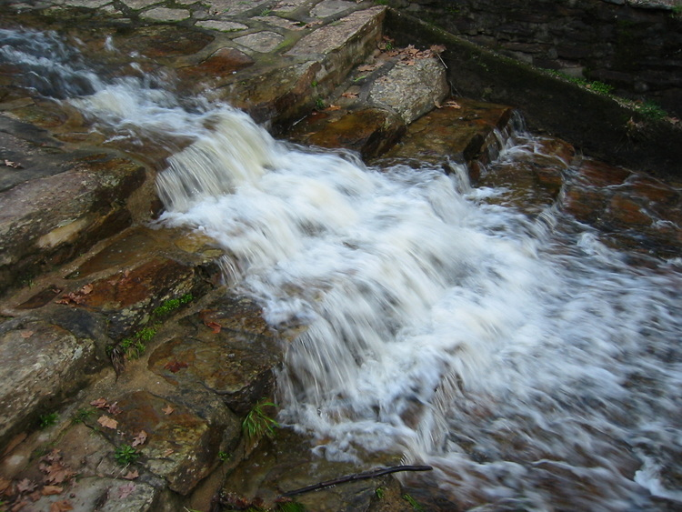 Water flowing over stone steps