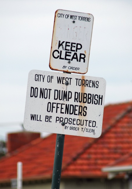 A sign reading 'Do not dump rubbish offenders'