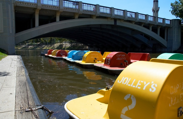 Colourful paddle-boats moored on the river