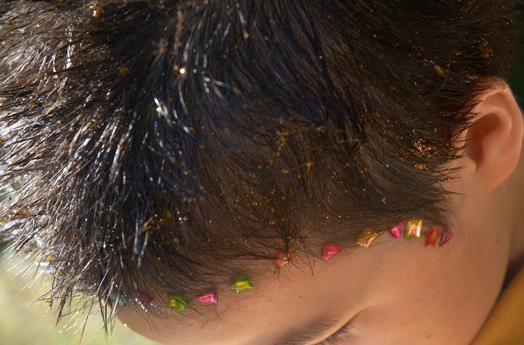 Closeup of michael's hair done up with glitter and stickers