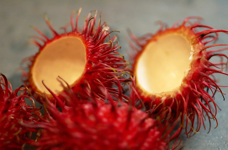 Rambutan fruit, whole and halved