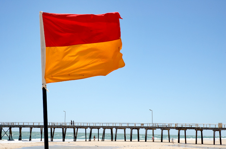 A flag in the foreground of a jetty