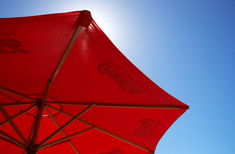 A red umbrella against a blue sky