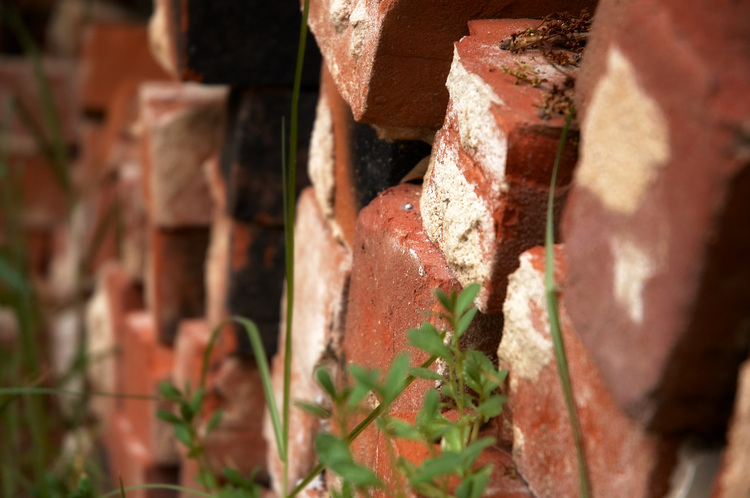 Closeup of a stack of old red bricks