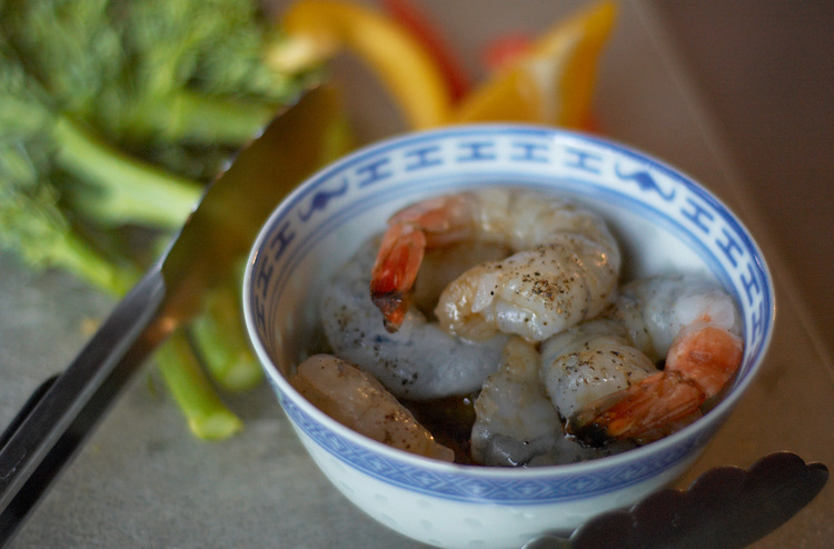 A bowl of uncooked prawns