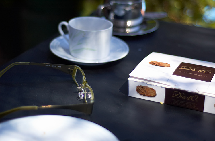 Reading glasses, coffee cups, and a chocolate box