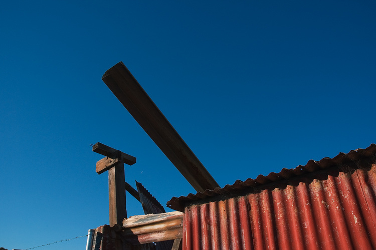Corrugated iron, against a blue sky