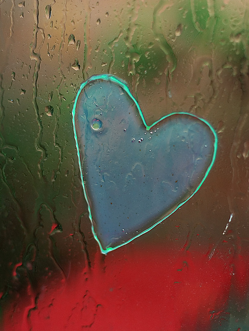 Rain drops and a heart-shaped sticky thing on a window
