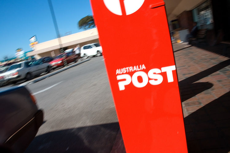 Motion blurred photo of a red post-box