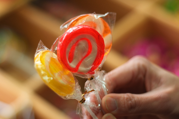 Three lollipops being held by a hand