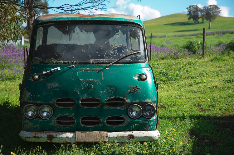 An old van abandoned in the corner of a paddock