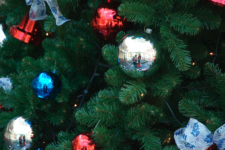 Closeup of Christmas baubles on a tree