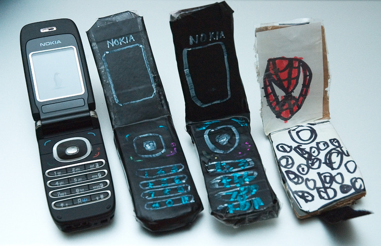Three replica mobile phones, and one real one