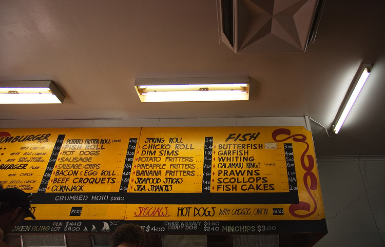The price board at a fish and chip shop