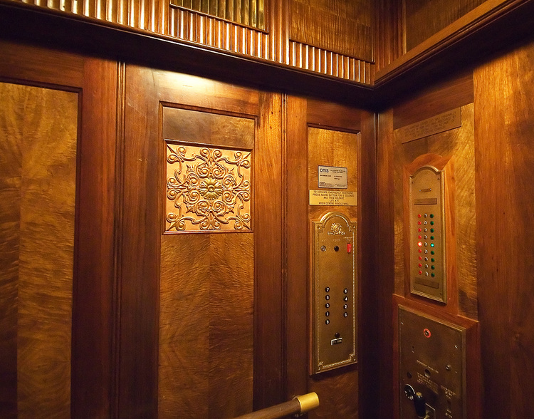 The wood panelled interior of 1930's lift