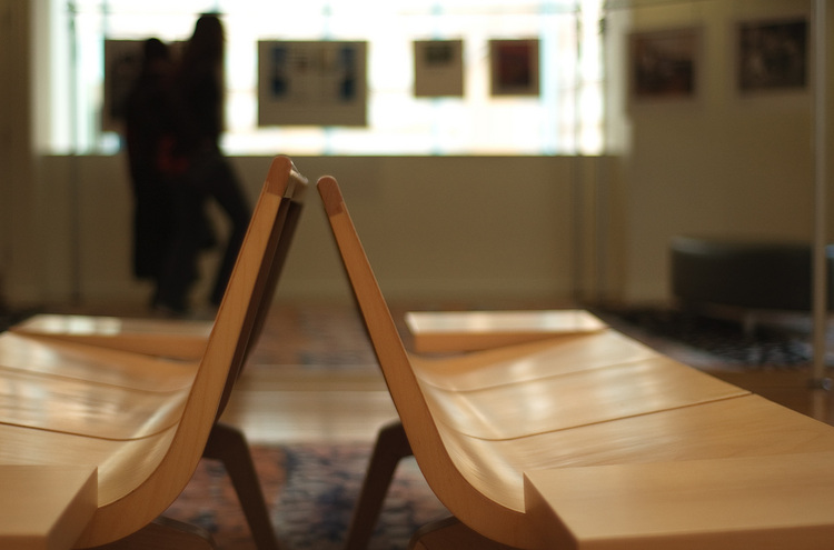 An end-on view of a pair of wooden benches