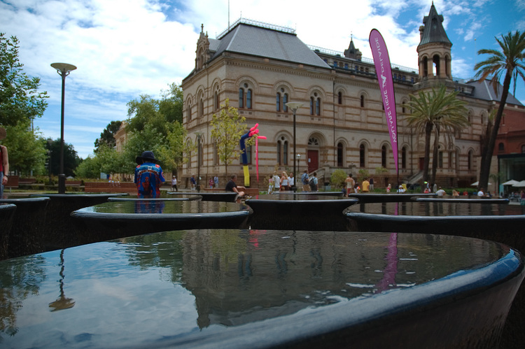 Water flowing over a sculpture in front of the South Australian Museum