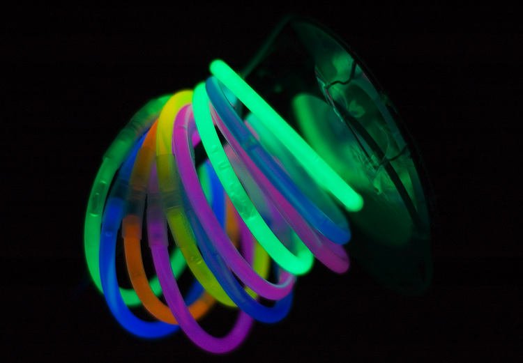 Glow-sticks, looped into circles