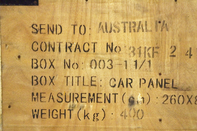 Stencilled lettering on the side of a wooden box