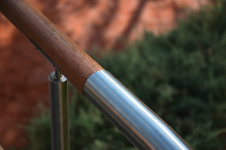 Closeup of a wood and metal handrail