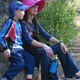 Michael and Theen rest on a rock