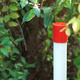 A red and white fire plug marker