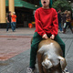 Michael sitting on a bronze pig sculpture in Rundle Mall