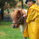 Michael leading a miniature horse